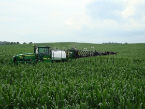 Sprayer applying fertilizer