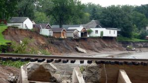 A mudslide (or landslide) consists of mud and other earth materials that fall down a slope, usually after a period of heavy rain.