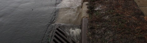 water running into storm drain