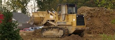 Payloader on soil pile