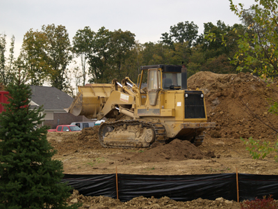 Payloader on soil pile