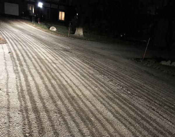 dark wet stripes on roads