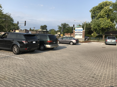 cars in parking lot with porous pavers