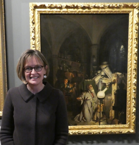 woman in front of oil painting in museum