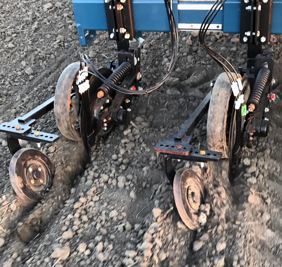 machine with tires and wheel adding fertilizer