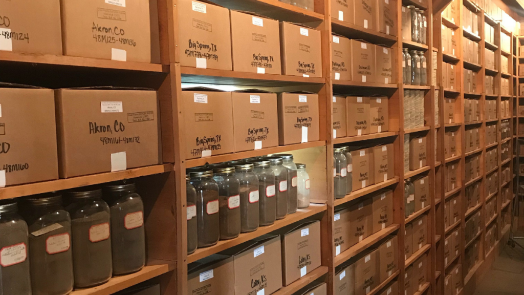dozens of labeled boxes and jars containing soil on shelves